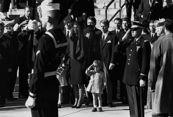John F. Kennedy Jr. salutes his father's coffin along with the honor guard