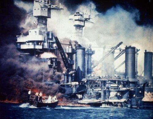 A rescue boat comes alongside the crippled USS West Virginia